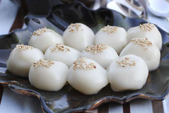 These sweet rice balls are usually eaten during the 15th day of the lunar New Year, also known as the Yuanxiao Festival.  The roundness of the dish implies peace and unity within the family.  Chinese New Year: food traditions - FabVietnam_Photography/Getty Images