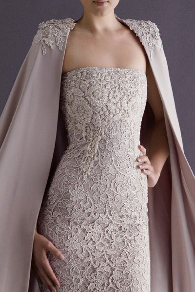 Paolo Sebastian silk crepe cape with lace shoulder detailing and strapless French lace pencil dress.