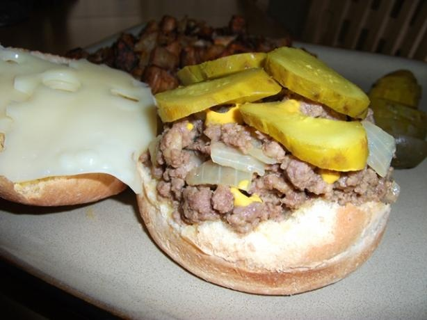 "Loose Meat Sandwiches are famous in the Midwest. I had never tried one, let alone heard of them until I searched the internet looking for ""what to make for dinner with ground beef."" It was a basic recipe but oh so good. I am not a fan of mustard so I kept it in the recipe but left it off of my sandwich, but added pickles and sliced cheddar cheese. Yum! FYI, this is what was served in the restaurant that Roseanne owned on her show."