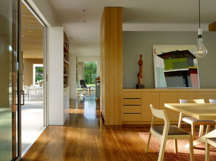 Alleyway in Home with Hardwood Floor and Wooden Dining Room near it