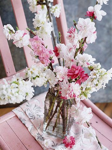 Branch out from the usual blooms and cut flowering shrub and tree branches for centerpieces: http://www.bhg.com/wedding/centerpieces/beautiful-wedding-centerpiece-ideas/?socsrc=bhgpin060814branchcetnerpiece&page=17