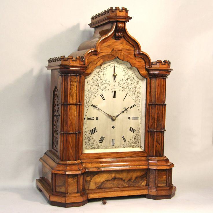 Chiming bracket clock. Large walnut case, triple chain fusee movement, superior quality, late 19th c. The substantial triple chain fusee movement with solid Anchor Recoil escapement, sounding the quarter hours on a nest of eight bells and the hours on a large coiled gong.
