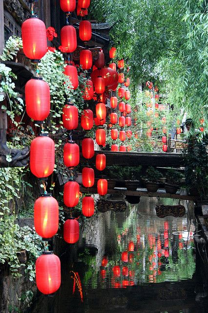 See the traditional red lanterns hanging in Old Town, Lijiang, Yunnan, China.