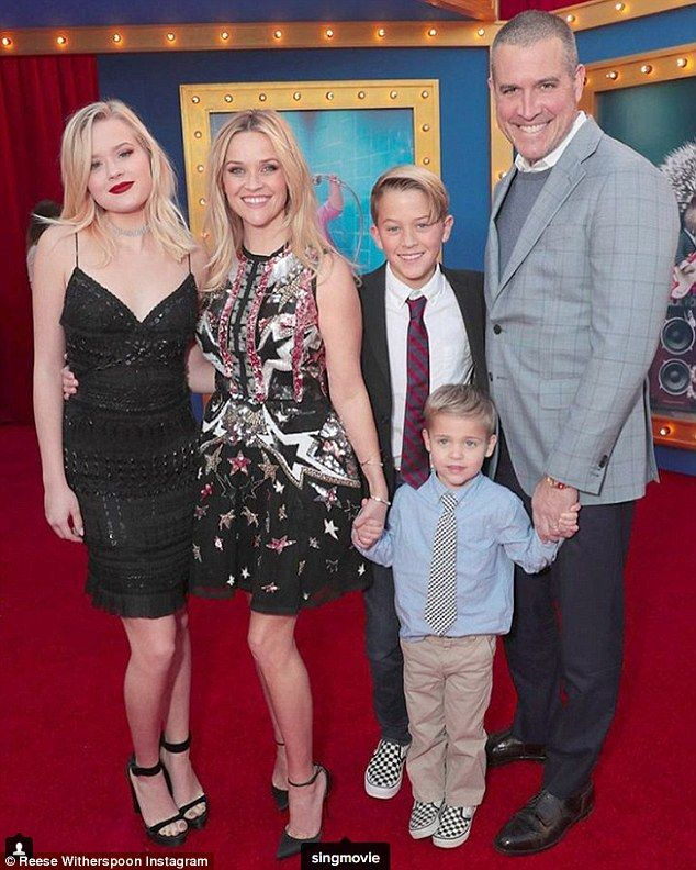 Smiles all around: Reese is married to agent Jim Toth; they have a four-year-old son named Tennessee James; Ava pictured with mom Reese, stepdad Jim and brothers Deacon and Tennessee at the Sing premiere in early December