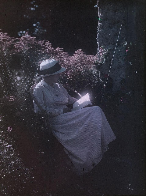 Reading in the garden 1915 - early color process. She must have amazing eyesight! Love the photo though