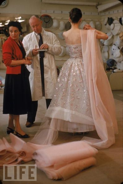 Christian Dior, a man never afraid to use lots of fabric. Great behind-the-scenes shot.