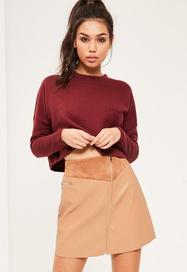Go for city chic styling with this a-line skirt. Featuring faux suede and faux leather materials and standout zip through feature to the front - meaning this skirt is seriously cool AF!