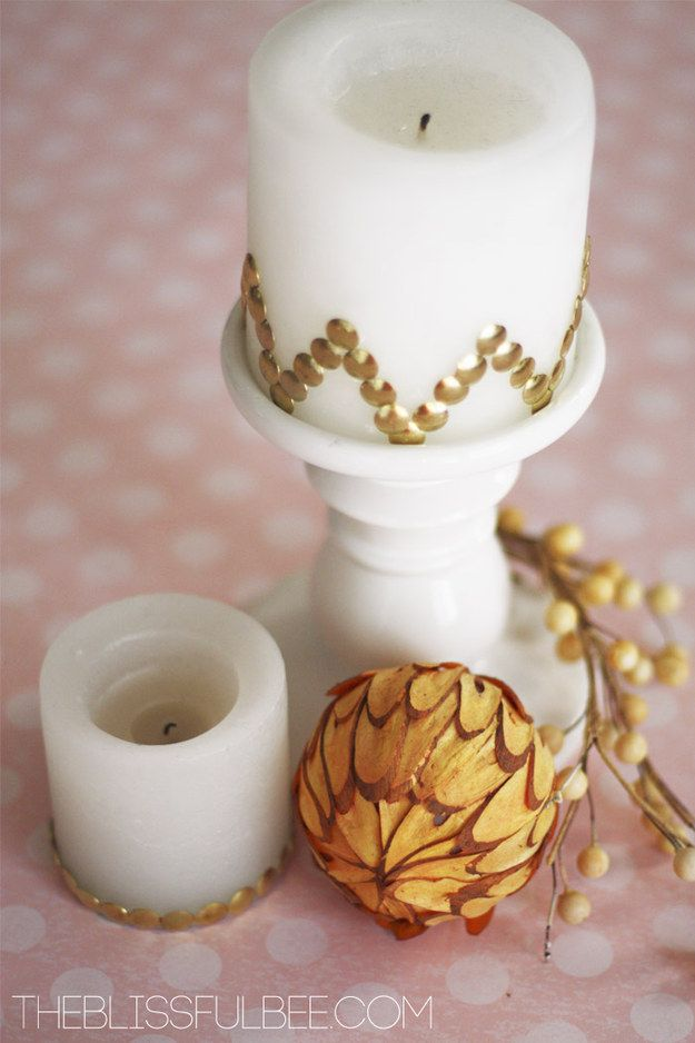 Use thumbtacks to add some glitz to any candle. | 19 Super Cute Dollar Store DIYs That Will Complete Your Bedroom