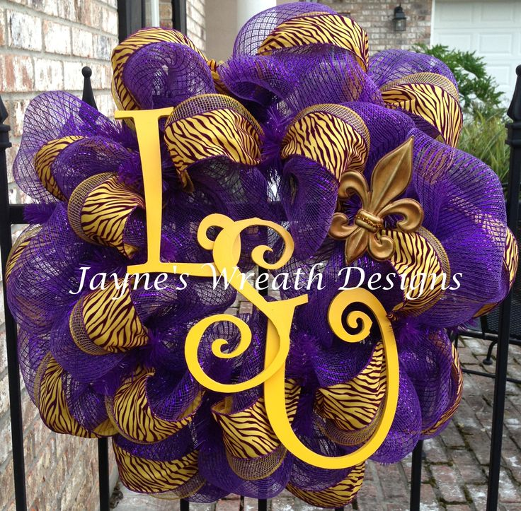 LSU deco mesh wreaths with Fleur de lis and tiger stripe ribbon perfect for football season! Geaux Tigers! Jayne's Wreath Designs on fb