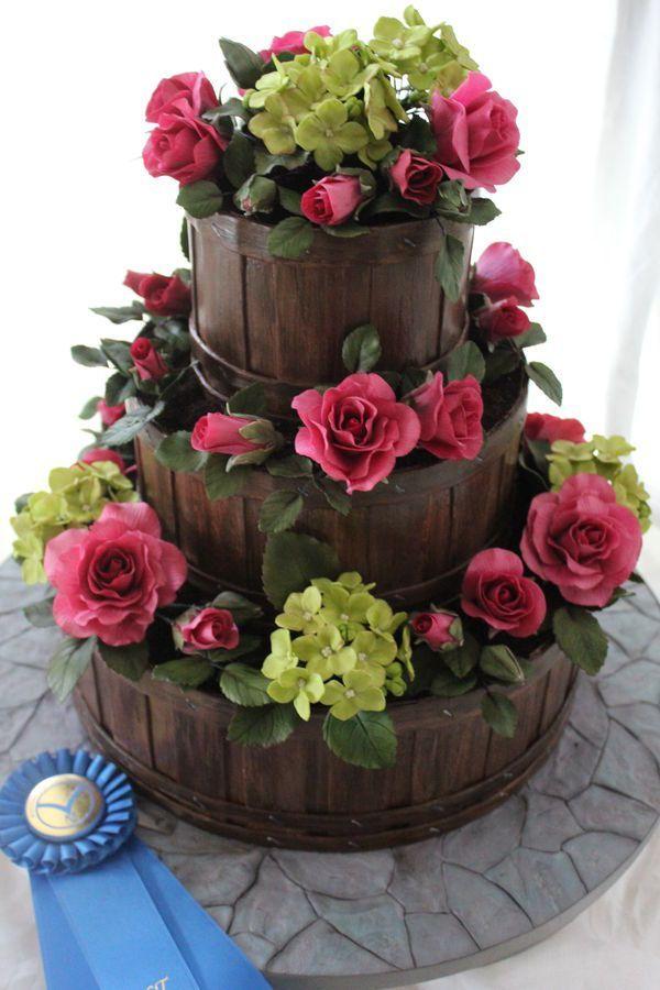 www.cakecoachonline.com - sharing...Flower Basket Wedding Cake Fondant wood grain slatted basket with roses and hydrangea flowers. Stone fondant cake board. 1st Place NCACS 2013 Professional Wedding Cakes.