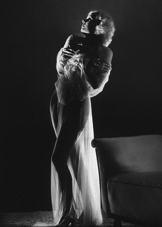 Jean Harlow standing semi-nude in a sheer gown, 1933.  Modern silver gelatin, 14x11 unsgned, $600  Photo by George Hurrell / MPTV