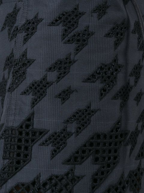 Shop Sacai graphic broderie skirt.