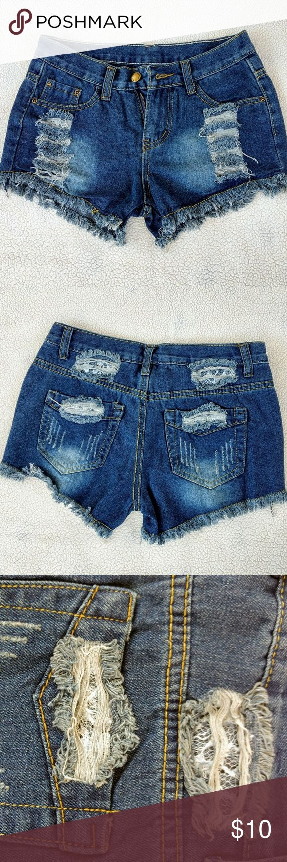 Lace underlay Ripped, Blue Jean shorts! Never worn before..... size small waist band 28inches shorts true to front and back photo ..camera went screwy on the close-ups .... no name Shorts Jean Shorts