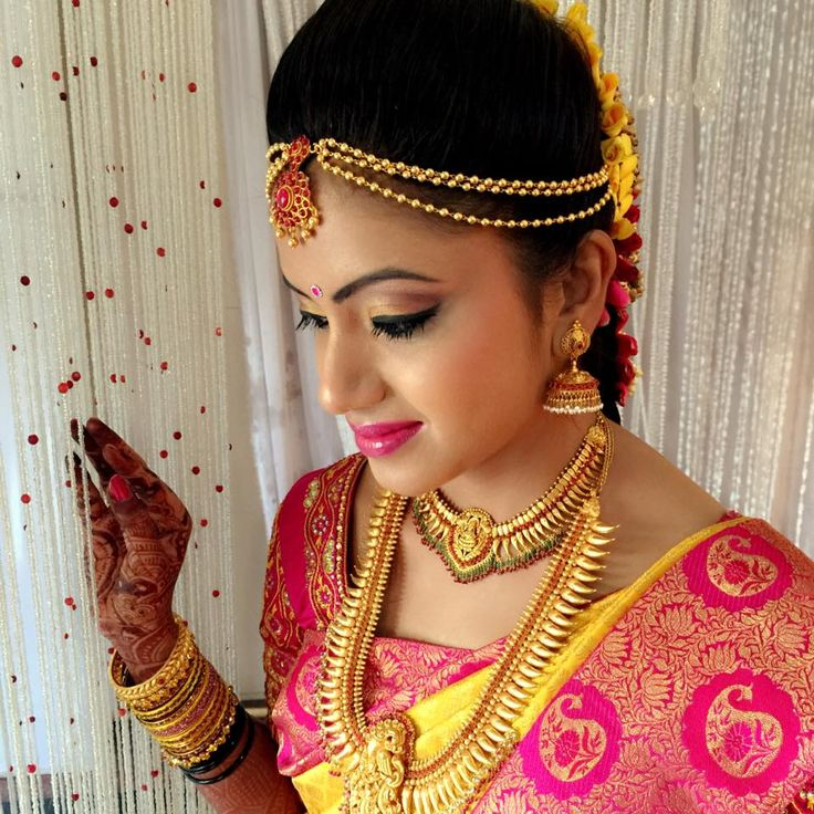 Traditional Southern Indian bride wearing bridal hair, saree and jewellery. Muhurat look. Makeup by Swank Studio. #BridalSareeBlouse #SariBlouseDesign   Find us at https://www.facebook.com/SwankStudioBangalore