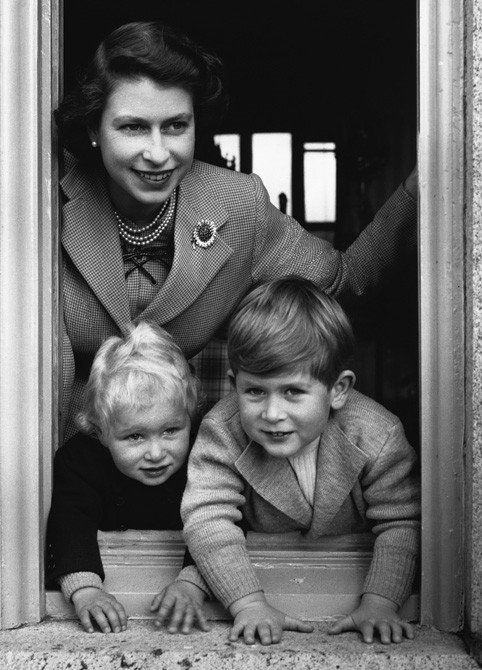 The Queen with her two eldest children, Prince Charles and Princess Anne. With the birth of Prince Andrew in 1960, the queen became the first reigning sovereign to give birth to a child since Queen Victoria, whose youngest child, Princess Beatrice, was born in 1857. She has eight grandchildren and one great grandchild.    %>
