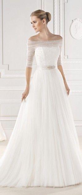 Off the shoulder sheer overlay belted wedding dress.