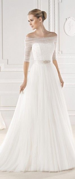 Off the shoulder sheer overlay belted wedding dress. If it didn't have the shoulder overlay I'd like it better.