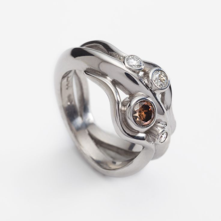 Modern 18ct white gold wave style engagement ring with 0.38ct cognac diamond and 0.19ct diamonds. Engagement rings Cork city.