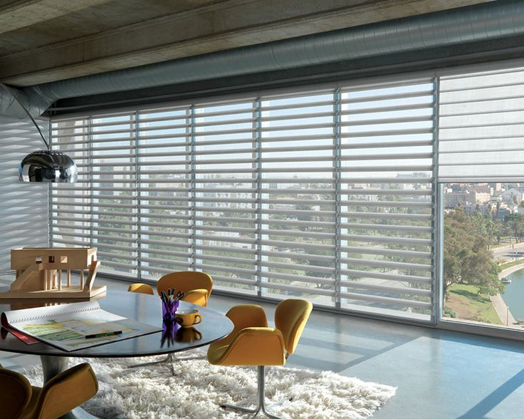 Adding a bright yellow accent makes a fearless home office decorative statement.  Pirouette® window shadings ♦ Hunter Douglas window treatments #loft