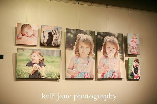 Photo Wall Display: Besides the composition and combination of sizes, I like the sequence of events of the 2 larger frames. An animated moment living on your wall keeps the display from being static.
