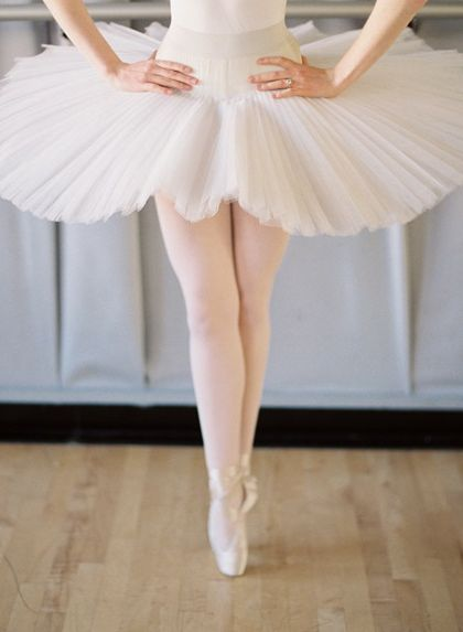 Wishing that I could dance in a quality hand sequinned pancake tutu! < ballet pose