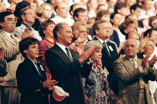 Prime Minister Pierre Trudeau, with son Justin, left, applauds during a Liberal convention in Edmonton on Thursday, June 14, 1984.
