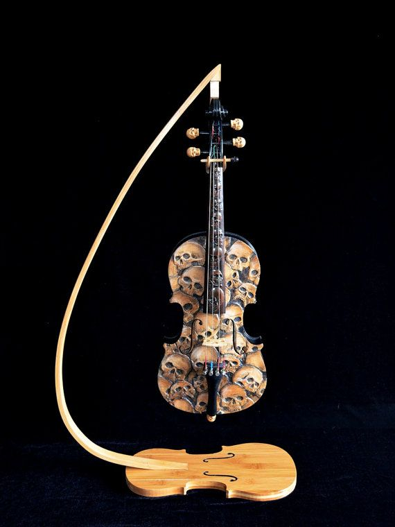 This is a custom carved and painted violin. This is NOT a functional violin, it is a piece of art. It is made to order. The one in the photos was donated to raise money to buy violins for a music program. I had so much feedback and so many requests, that I decided to make it again, to order. It will be very similar, but every carving is unique. In addition to Skulls, I can do most any theme. Price will vary by design. The Price is for this one which takes up to 50 hours to carve, allow 3…