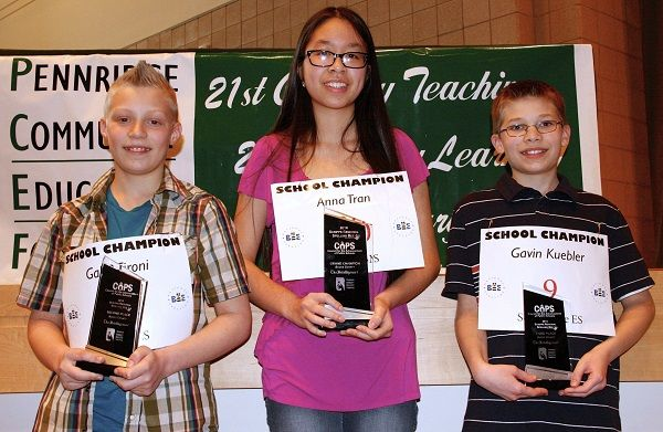 Gabe Tironi, second-place winner and a fifth-grader from J.M. Grasse Elementary School in Sellersville; Anna Tran, overall winner and an eighth-grade student at Strayer Middle School in Quakertown; and Gavin Kuebler, third-place winner and a fifth-grader from Sellersville Elementary School in Sellersville, hold their trophies following the Bucks County Spelling Bee. The bee was held at Pennridge High School March 29. Photo courtesy of the Star Group