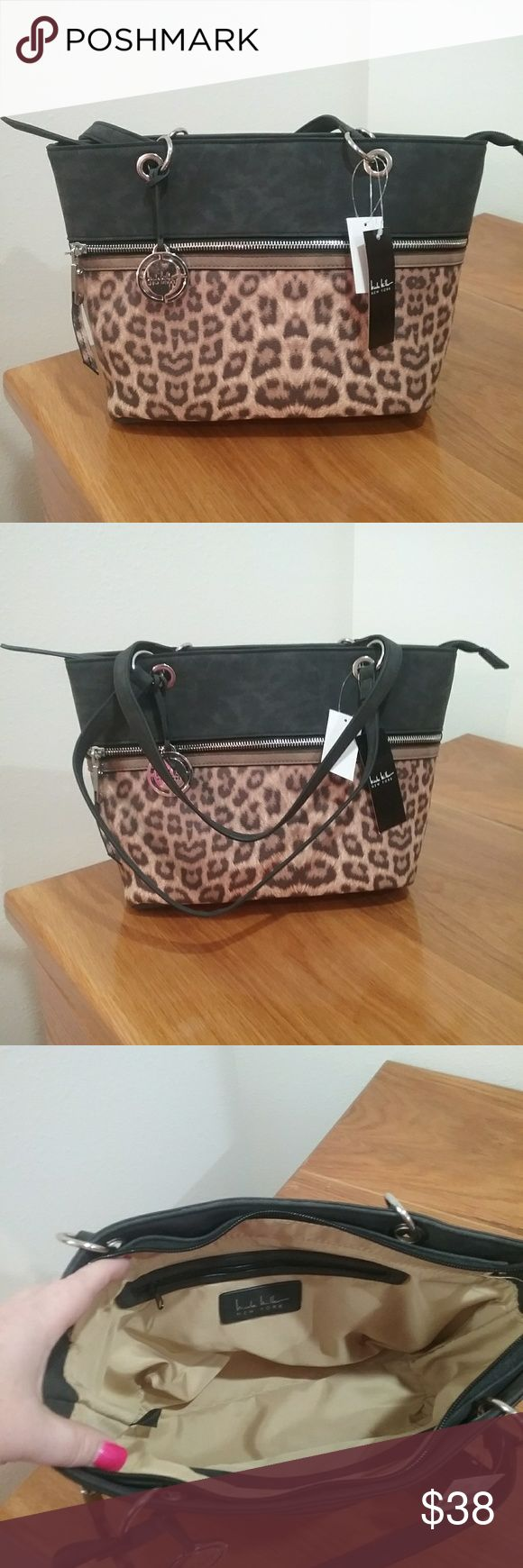 BNWT chic cheetah purse! Brand new Nicole Miller tote handbag in a nice cheetah/black print with zipper pouch across the front and back.  Inside is tan and black with small pouch and another zippered pocket.   Very classy and chic! Nicole Miller Bags Totes