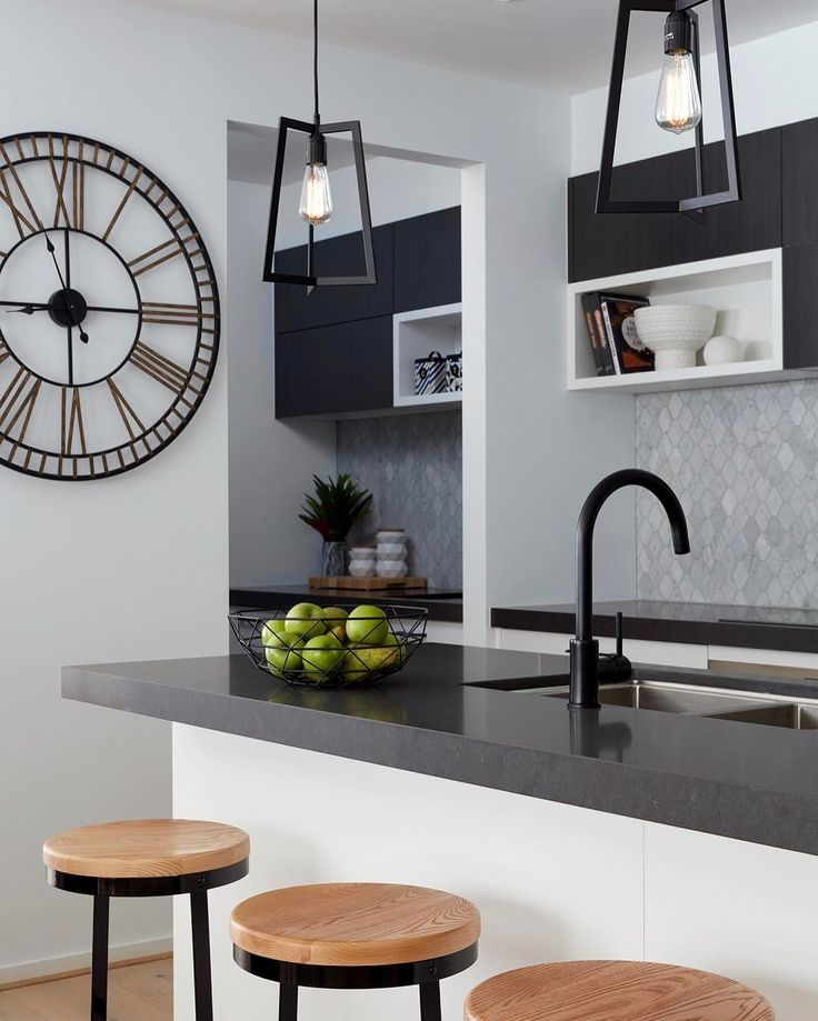 @boutiquehomesvictoria 'Barcelona 28' draws inspiration from New York loft style living with soft timber finishes matt black furnishings plenty of natural light The two tone slate grey finish on Caesarstone Raven benchtops creates a stunning texture and tactile appearance #weareinlove #caesarstone