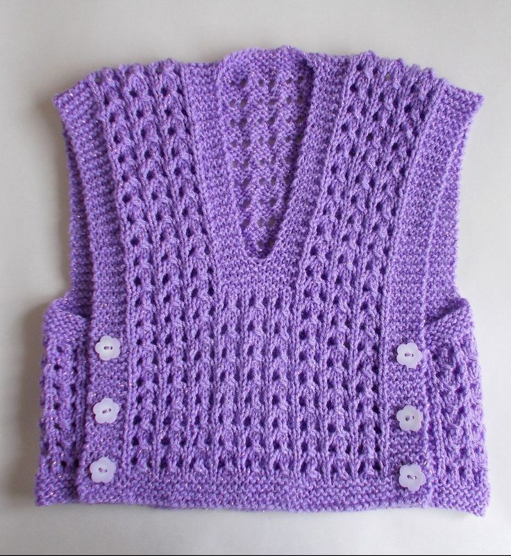Free Knitting Pattern for Melika Lacy Baby Vest Top -   marianna mel's easy lace baby vest is knit in one piece with no seams. Two sizes: 6 months and 1 year.