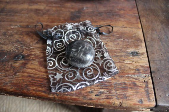I find Black Moonstone to be a very deep and interesting stone... deep vision work!.....with protective and grounding properties, along with the moonstone properties of femininity, intuition, dreamwork, abundance & lucky energies.... Black moonstone is said to be a stone of financial security and prosperity- it also helps bringing grounding and clarity.  on the general properties of Moonstones: connecting to the feminine, to the intuition, to water, to the moon- brings about serenity, inn...