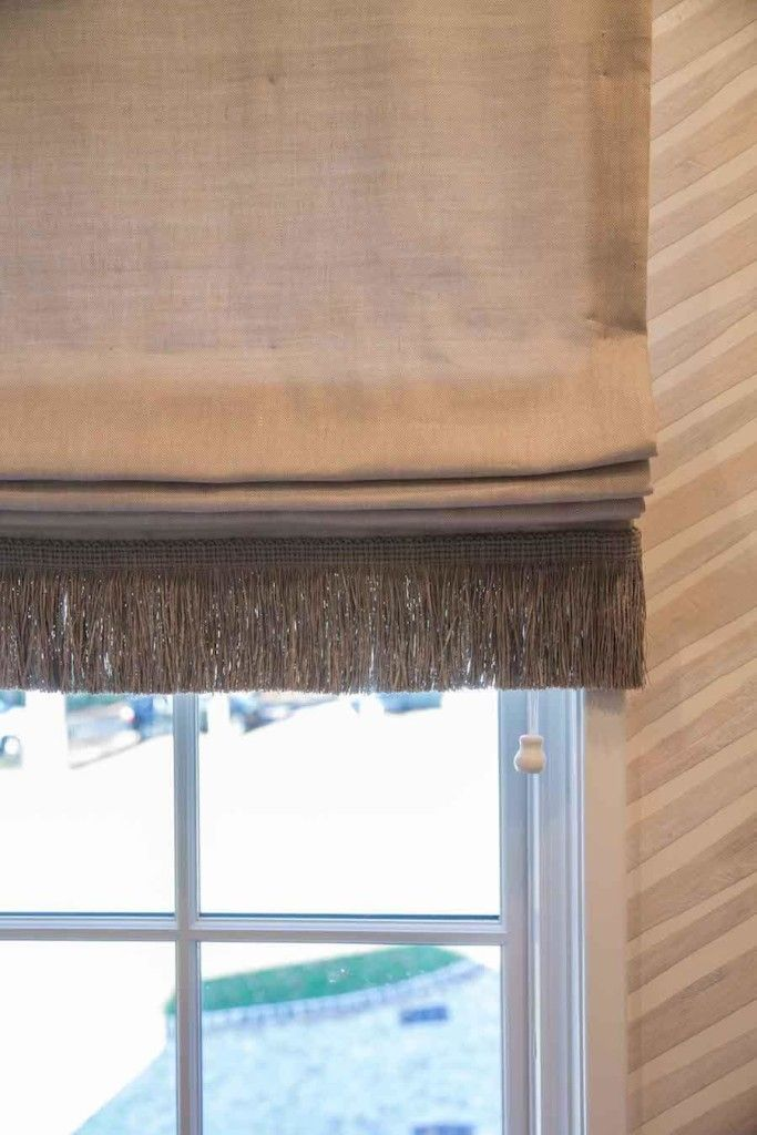 Window Treatment by K and K Interior Design Neutral roman blind with brush fringing to add a bespoke touch