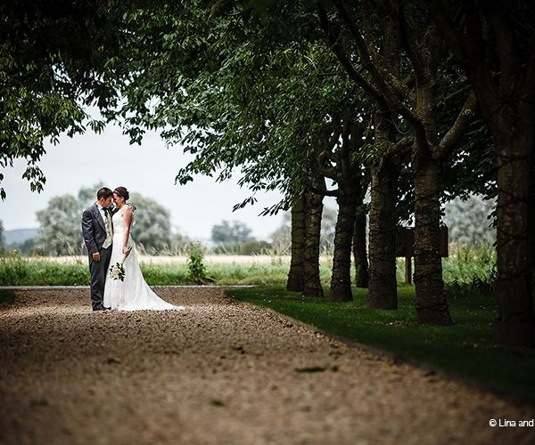 A stroll in the grounds at South Farm wedding venue in Cambridgeshire   CHWV