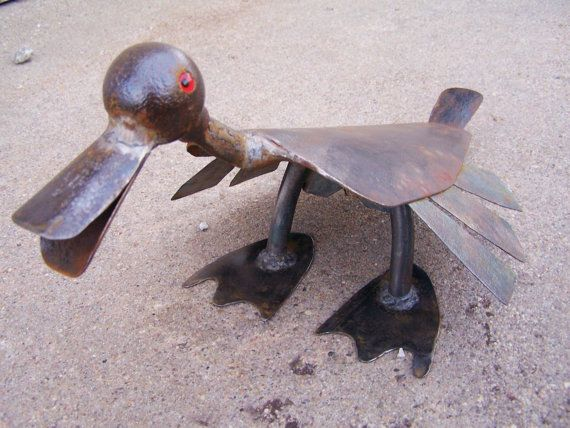 Flat billed bird garden art sculpture