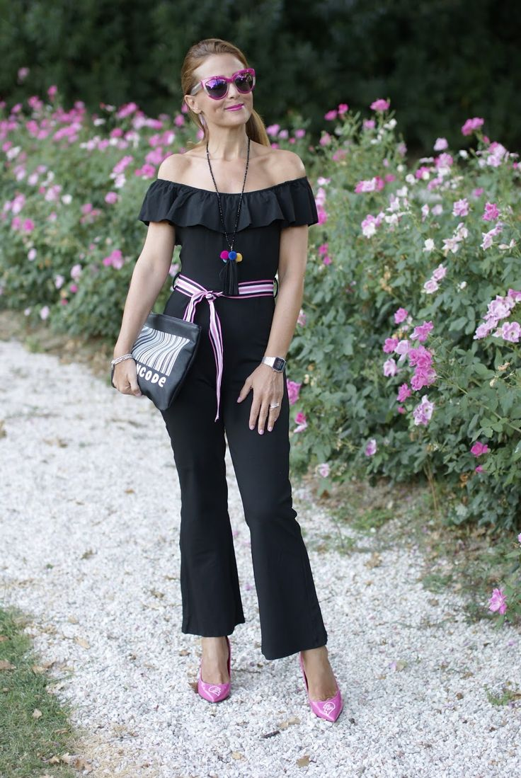 Black off the shoulder jumpsuit and Pink Sister Pumps by Angela Pavese