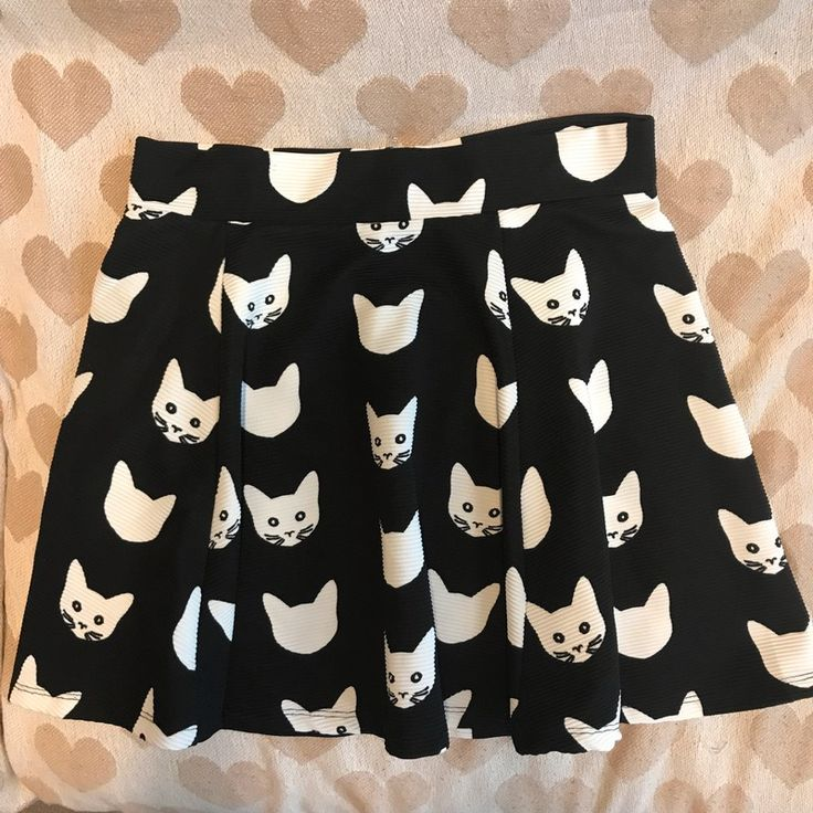 Worn but still in good condition, thick material makes it perfect for winter and fall, above the knee length, cat pattern