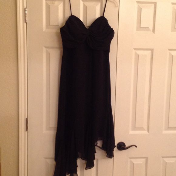 ⚡️ Flash Sale ⚡️ Asymmetrical Black Formal Dress Beautiful Black dress perfect for any occasion. Worn only once. Gathered detail at the chest. Fitted through the bodice with a flowing hemline. Fits like a 6/8. Dresses Prom
