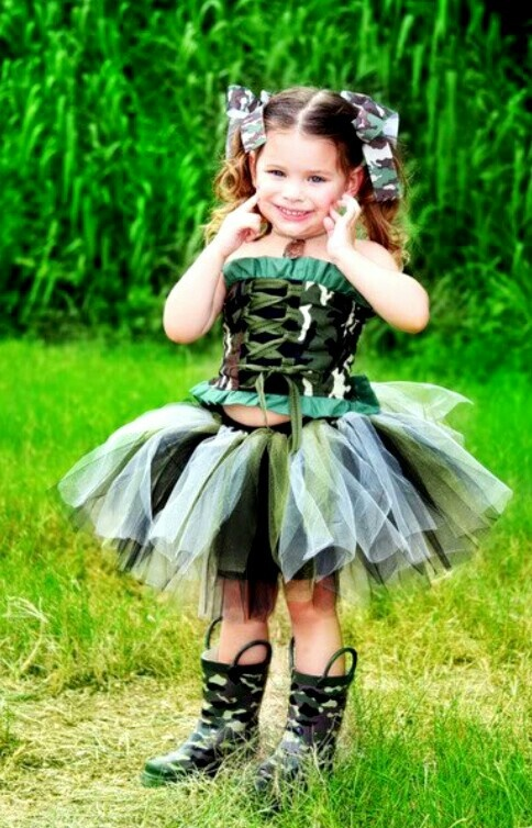 Little Girl Dressed Up In Camo