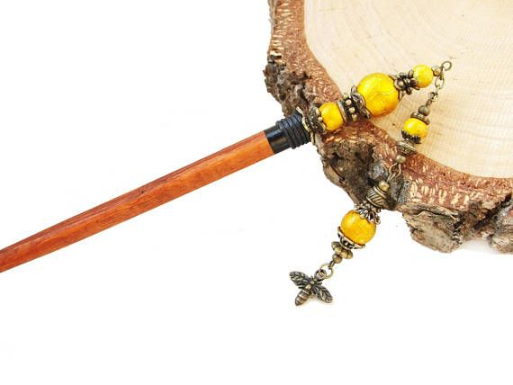 Wooden hair stick with yellow spectra beads and bee charm
