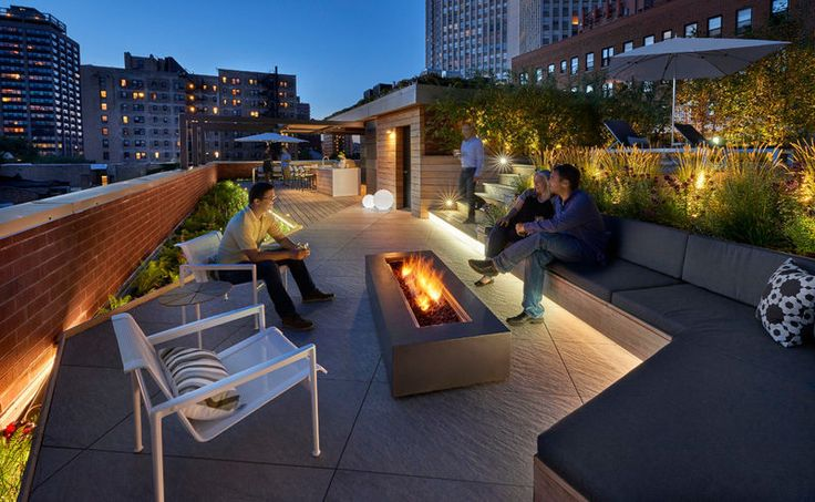 7 Design Lessons To Learn From This Awesome Roof Deck In Chicago // Warm it up with a fireplace -- If you're going to be enjoying your deck at night or in the cold, a fireplace is always a good option for warming the space up, as well as creating a natural gathering point for people to sit around.