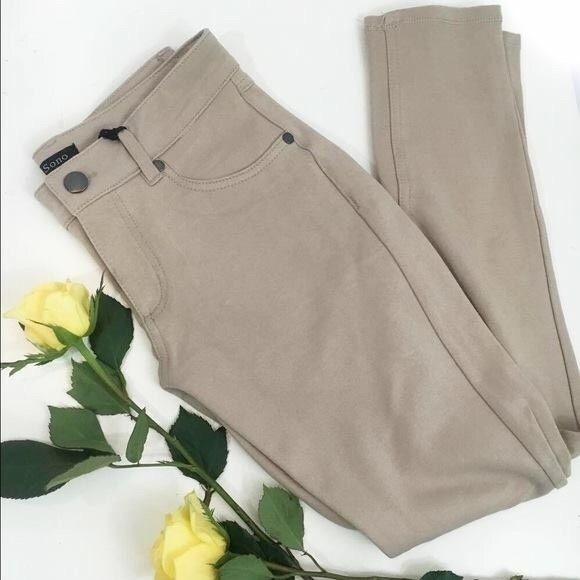 Khaki Skinny Pants with Stretch Patched pockets back skinny pants with side pockets Width : 13''inches Full length : 33.5''inches Leg length : 24.5''inches 68% Rayon 27% Nylon 5% Spandex Made in Vietnam  100% of the profits from any sale in my closet are donated to help someone in need. Naturally Spiritual Boutique Pants Skinny