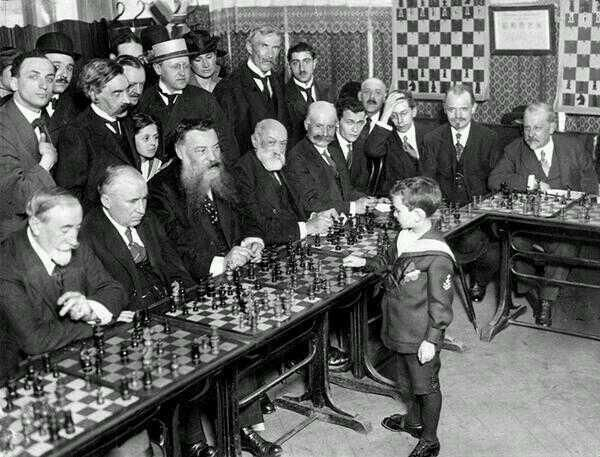 8-year old Samuel Reshevsky defeating several chess masters at once in France, 1920