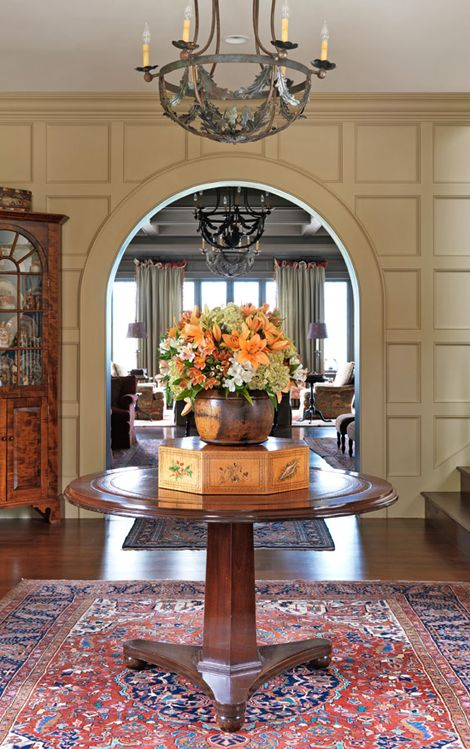 Entry Foyer Pedestal Table : A paneled entryway is accented with beautiful vintage