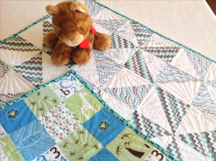 Baby quilt or tummy time plate mat in grey/white & aqua pinwheel design. https://www.etsy.com/your/shops/QuiltsandSewsShop/tools/listings/278357574