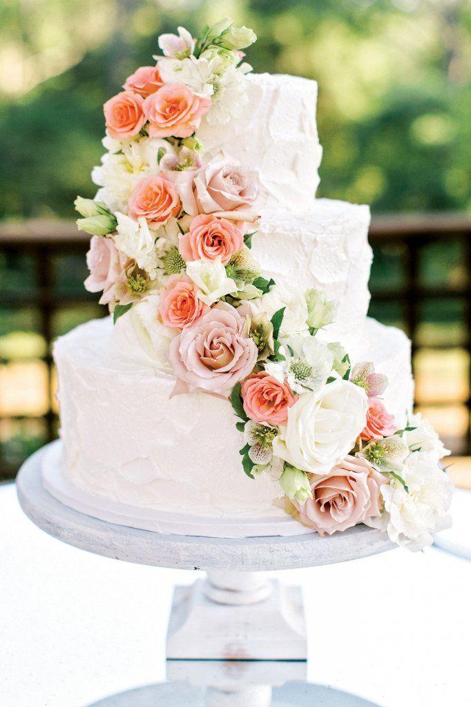 Pretty wedding cake with cascading flowers
