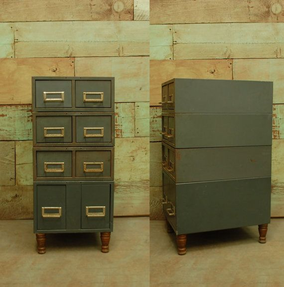 vintage industrial filing cabinet. love the wooden feet.