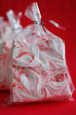 Homemade Marshmallows with peppermint extract, swirled with red food coloring. No bake. No egg whites. Adapted from Alton Brown. Just tried this recipe -super easy- as an experiment for gifts for Shea's employees and mine as Xmas gifts. Will see...