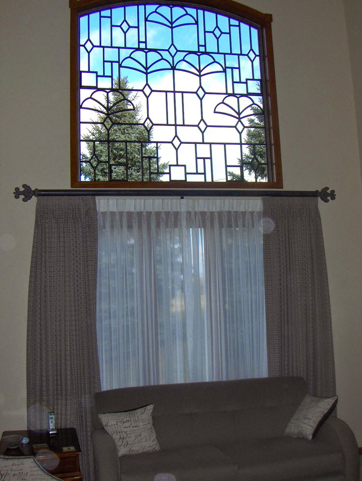 more of the custom iron work with draperies and sheers on a decorative traverse rod custom window