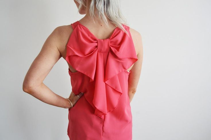 Bow Back Tank in Coral – The Obsessions Boutique  Ladies fashion, ladies accessories, ladies fashion boutique, online boutique, ladies tank tops, ladies sweater, ladies date night, date night outfits, ladies outfits, ladies apparel, ladies shoes, adorable